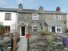 Charming character cottage with approx. 5.5 acre paddock nearby & outbuildings...